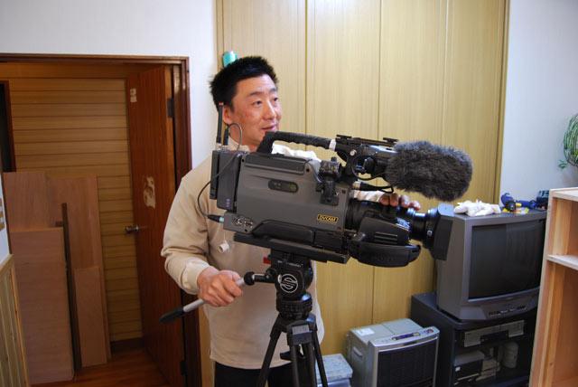 プロカメラマンの小松さん。