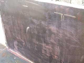 塗膜撤去後の鉄板面。